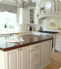 There are some GREAT pointers on here on how to paint your cabinets so they don't have brush strokes or peeling paint and last a long time!