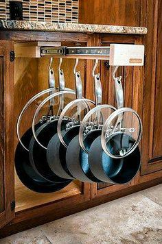 Gliding pot hanger for cabinet storage