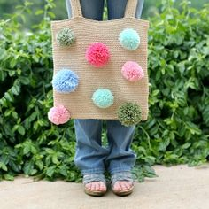 Update an old tote with some festive pom poms!