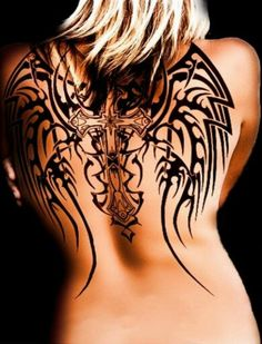 LOVELY WOMAN WITH A COOL CELTIC TRIBAL CROSS TATTOO ...