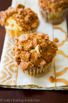 Super-moist Pumpkin Spice Muffins filled with cheesecake and topped with brown sugar streusel. So good! sallysbakingaddiction.com