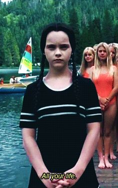 I was in love with the Adams Family movies as a kid, I even had their poster on my wall which matched my black and white bedroom theme.  Wednesday Addams