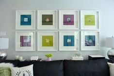 Fun, easy way to DIY showcase 3x3 instagram prints with pops of color in big frames to cover an empty wall [Our Living Room Art Switch | Young House Love]