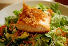 Chopped Salad topped with Tobacco onions and seared Salmon at Harth Restaurant