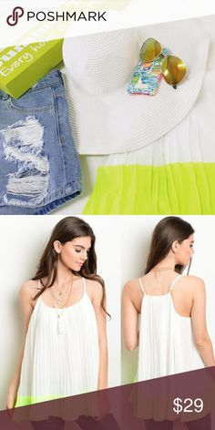Neon pleated top Neon yellow and white pleated strap top. Polyester. 28 inches long. Imported.  Sizing: Small (2-4), Medium (6-8), Large (10-12) Tops Blouses