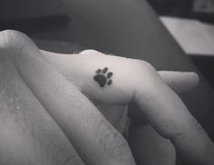Dainty dog paw tattoo for my golden retriever Max! Love the placement.:
