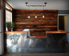Rustic wood wall, industrial pipe pendant light, reclaimed metal & natural edge wood reception desk by Steelhouse designs  facebook.com/steelhousedesigns @steelhouse_designs