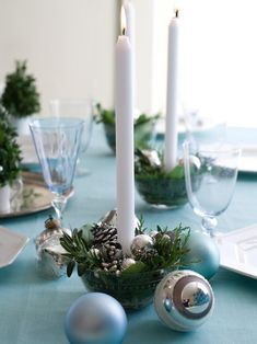 Festive candleholders are created by placing low votives in a glass bowl. Fill in around votive with cones, pods and clippings of evergreen. Make several to go down the center of the table or to dress up the bar. Scatter around glass ornaments for extra sparkle.