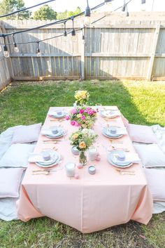 Pink & Peach Easter Dinner Party~ find recipes and full party deets on the blog~  #easter #party #inspo #ideas #backyard #low #table #picnic #pink #peach #white #gold #wedding #tablescape #diy #unique #setting #flowers #candles #decor #blog