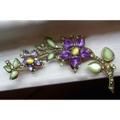 MONET Purple Flowers Green Leaves Brooch, Long Curvy, Moonglow... ($39) ❤ liked on Polyvore featuring jewelry, brooches, rhinestone jewelry, purple flower brooch, flower jewellery, rhinestone brooches and purple jewelry