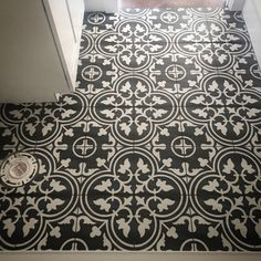 Black and white patterned tile with black grout from Joss and Main. Similar tile found at Home Depot. Farmhouse/Modern farmhouse first floor bathroom.