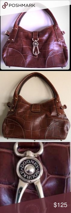 """❌SOLD❌Dooney & Bourke Logo Lock Leather Satchel This rare bag from the Soft Croc collection is absolutely stunning! In nearly new condition, inside and out. The interior has a zip pocket, phone pocket and a key hook. The outside is a beautiful brown crocodile embossed leather. The strap drop length is 7 1/2"""".   ❎NO TRADES. 👜Reasonable offers considered👜  💎To assure that you receive the product you ordered in the condition described, THIS ITEM WILL BE CAREFULLY VIDEO RECORDED FROM…"""