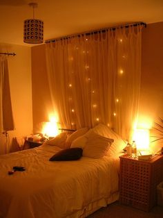 Curtain headboard with string lights. Gorgeous!