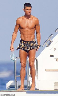 Ripped! Cristiano displayed his ripped physique as he went shirtless in a pair of black pa... Cristiano Ronaldo Girlfriend, Cristiano Ronaldo Junior, Cristano Ronaldo, Black Bikini, Man Crush, Swim Shorts, Celebrity Photos, Physique, Girlfriends