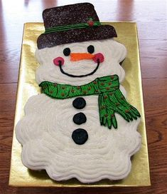 Snowman Cupcake Cake - My first cupcake cake! Made for my daughter's 7th birthday in school and the classroom holiday party. 24 yellow cupcakes with vanilla BC icing. Sprinkled with white sparkling sanding sugar. The hat is solid milk chocolate. This was so much fun to do.