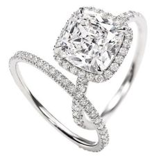 Cushion cut with halo setting.     Yes, we have many :)    Facebook.com/MauriceJewelry    emaurice.com