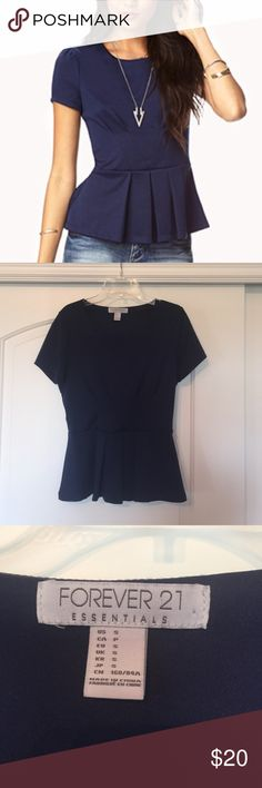 Pretty Peplum Top Perfect condition! Thick, stretchy material. Forever 21 Tops