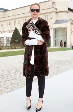 Great look: Elbow length fur + printed clutch + black skinny pant + pointed patent shoe. #style #streetstyle #fashion