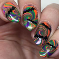 bats n stuff! #watermarble! these were inspired by @honeybee_nails, she used these same polishes in a gradient with bats stamped on top (they're amazing!!) and this idea instantly popped into my head. colors used: @pipedreampolish 'harlequin', 'rhythm' and 'tabanca'. i used my 'pure color 7 watermarble tool' from @whatsupnails to make my design. the bat vinyls are also from @whatsupnails