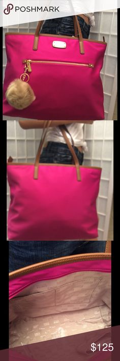 Large NWT Michael Kors fuchsia Tote Large size, new with tags, zipper closure, inside 4 open pockets and 1 zipper pocket, color fuchsia brown, front 1 zipper pocket. Thank you for looking Bags Satchels