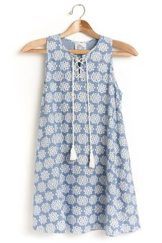 Beautiful cornflower blue with eyelets dress. 100% cotton. Perfect to wear alone or layered with a cardigan.