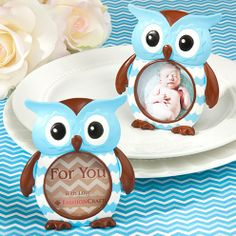 Owl exciting! A new baby boy! These Blue Owl Design Picture Frame/Place Card Holder Favors are perfect for your mod mom�s owl themed baby shower. Measuring 3 inches wide x 3 1/2 inches tall the resin frame is hand painted with popular blue and white chevron stripes on the body, with chocolate brown wings, feet, beak, and crown. Display a photo, placecard, or the included �For You with Love� insert in the 1 7/8 inch diameter picture window. A fill-in placecard insert is also included with…