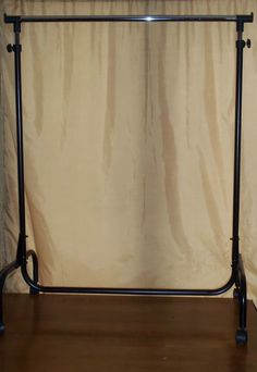 save money with a clothes rack for a backdrop holder! I am so doing this!