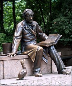 Hans Christian Andersen with a duck, New York. Sculpture by Georg J. Lober, 1956.