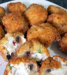 Stuffed fried mushrooms - Golden, crispy fried mushrooms, stuffed to the brim with cheese, bacon and chives.