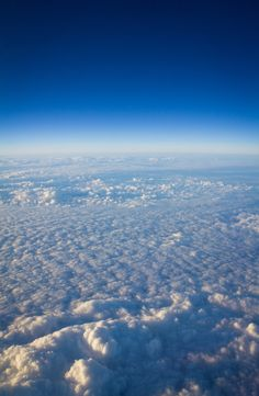Aeriel view of clouds with blue sky in the distance