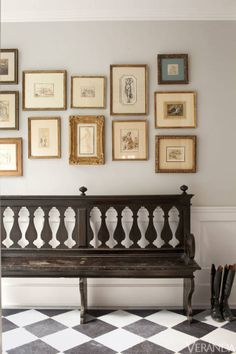"""In a small adjacent hallway, Shapiro kept things a bit more stately, deploying old master drawings, with mismatched frames and mats, hung in a manner that looks assembled over the years. """"I try to be unselfconscious about those things,"""" he says. """"I don't like to do anything that seems gratuitously decorative. It always has to have its own spirit and soul."""" Flooring, Exquisite Surfaces. Antique Florentine bench and old master line drawings, all Richard Shapiro Antiques and Works of Art."""