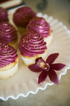 Top your wedding cupcakes with plum frosting and gold sugar crystals for a hint of glam! {Photo by Jennifer Manzi Photography, cupcakes by Abby's Dessert Bar}