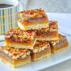 The Best Pecan Pie Bars. This easy recipe includes a simple shortbread bottom an… The Best Pecan Pie Bars. This easy recipe includes a simple shortbread bottom and a one bowl mix & pour topping. Tips for baking and cutting them are included. Pecan Desserts, Pecan Recipes, Easy Desserts, Baking Recipes, Cookie Recipes, Delicious Desserts, Yummy Food, Baking Desserts, Healthy Desserts