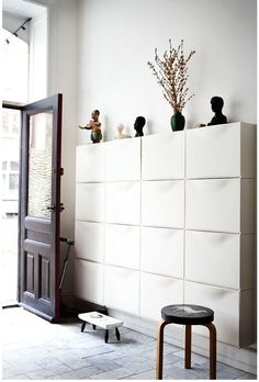 Styled entryway foyer full of wall-mounted IKEA TRONES shoe storage boxes