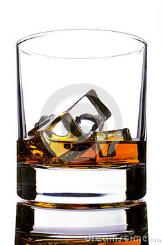 Glass of whiskey and ice on a white desk