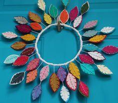 Bright Felt Feather Wreath - Unique and Modern Wreath - Colorful Bohemian Wreath - Boho Decor by CuriousBloom on Etsy https://www.etsy.com/listing/252365652/bright-felt-feather-wreath-unique-and