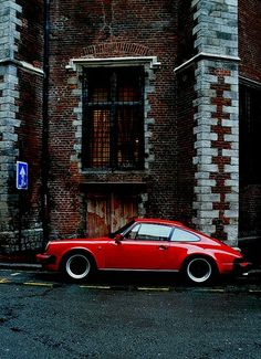Porsche 911  I love the blend of the fantastic car and the classic architecture!