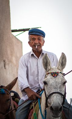 This is my Greece | Old man riding his donkeys to the donkey station in Fira, Santorini