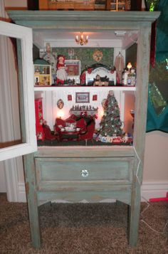Hutch converted into a miniature Christmas Dollhouse by Sheila A. Nielson