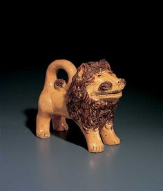 """LION, attributed to John Bell (1800-1880), c. 1850–1860, glazed red earthenware, 8 x 8 1/2 x 4 1/4"""", collection American Folk Art Museum, gift of Ralph Esmerian, 2005.8.25 Photo © John Bigelow Taylor"""