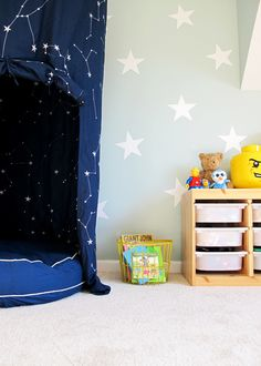 DIYed sensory friendly playroom with Palladian Blue walls and star decals