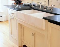 buttercream cabinets and black counters