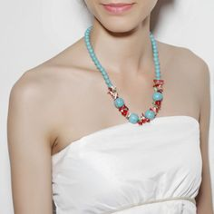 Beaded Turquoise Necklace  This beaded chain necklace features four big chunky turquoise beads alternating with five clusters of multicolor shells and corals.The Shell Coral Beaded Turquoise Necklace will make a striking statement on your neck.