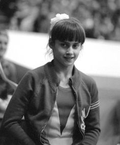 At Nadia Comaneci became the first person in Olympic history to score a perfect 10 in gymnastics, but after that moment, her life began to fall apart. Gymnastics Academy, Gymnastics World, Sport Gymnastics, Olympic Gymnastics, Gymnastics History, Rhythmic Gymnastics, Nadia Comaneci Perfect 10, 1976 Olympics, Stories Of Success