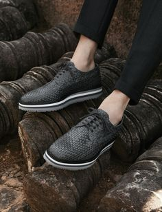 Prada lace-ups in gray woven leather