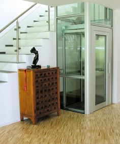 Accessibility with style: a glass home elevator by Artisan Elevators Dream Home Design, Home Interior Design, House Design, Elevator Design, Glass Elevator, House Elevation, House Plans, Stairs, Architecture