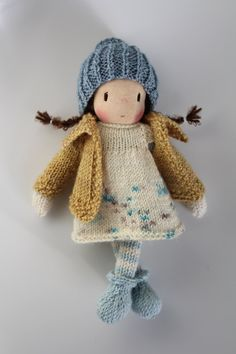 Shy little Katie. Katie is a small knitted Waldorf inspired doll made in The Netherlands from all natural materials: Swiss cotton knit doll fabric, clean carded wool, eco and fairtrade hand dyed merino yarn and a crocheted curly mohair wig. Her face is hand embroidered and her cheeks are blushed with Stockmar beeswax crayon. She is about 8 inch (20 cm tall). This sweet little doll will become your very best friend. Katie is handknitted by me from luxuriously soft eco and fairtrade Merino…