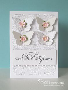 handcrafted Core'dinations wedding card ... almost all with embossing folder texture ... 2X2 punched and embossed butterflies with small pink flowers ... sweet!