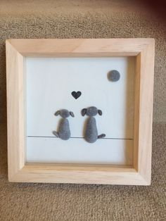 Pair/trio of dogs sat looking into the horizon. Can be done to include any number of dogs and can be produced with or without the love heart - please state your preference when purchasing.  Please note that due to the nature of the craft, pebbles may vary slightly from the ones shown in the picture.