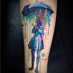 Watercolor style tattoo of a woman holding an umbrella. Tattoo Artist: Victor Octaviano